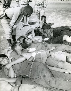 377px-Wounded-on_wayto-hospital-RG-208-AA-158-A-015